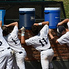 Enid Plainsmen's Zac McEachern, Ambren Voitik, Hayden Priest and Koby Hudson grab a drink between innings against the SW Shockers Red during the opening day of the Connie Mack state tournament Wednesday July 12, 2017 at David Allen Memorial Ballpark. (Billy Hefton / Enid News & Eagle)