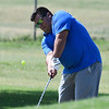 Lee Elliott chips onto the 9th green during the President's Cup Saturday July 29, 2017 at Meadowlake Golf Course. (Billy Hefton / Enid News & Eagle)
