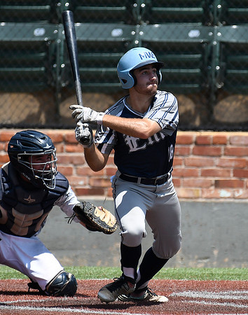 Enid Majors' Seth Graves connects on a base hit against the Albuquerque Cage Rats scores during an elimination game in the Connie Mack Regional Tournament Thursday July 20, 2017 at David Allen Memorial Ballpark. (Billy Hefton / Enid News & Eagle)