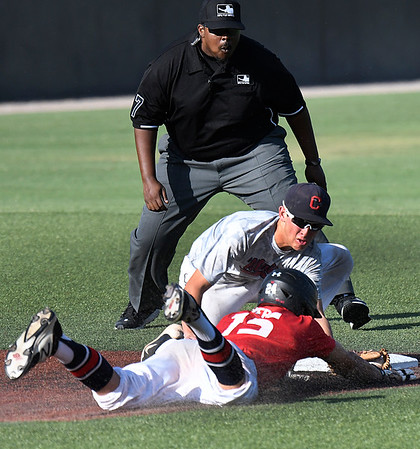 Jack Pineda of the Albuquerque Cage Rats tags out Oklahoma Expo's Christopher Herb during an elimination game in the Connie Mack Regional Tournament Friday July 21, 2017 at David Allen Memorial Ballpark. (Billy Hefton / Enid News & Eagle)