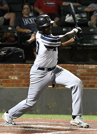 Enid Major's E.J. Taylor gets a base hit against the SW Shockers Black during elimination game in the Connie Mack state tournament Friday July 14, 2017 at David Allen Memorial Ballpark. (Billy Hefton / Enid News & Eagle)