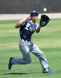 Enid Major's Ben Moreno makes a running catch in center field against the OKC Broncos during an elimination game in the Connie Mack state tournament Thursday July 13, 2017 at David Allen Memorial Ballpark. (Billy Hefton / Enid News & Eagle)
