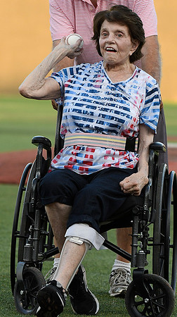 Joan Allen throws out the first pitch prior to the Enid Majors game against the Northern Colorado Roughnecks during the Connie Mack Regional Tournament Tuesday July 18, 2017 at David Allen Memorial Ballpark. (Billy Hefton / Enid News & Eagle)