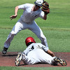 Ambren Voitik tags out Hunter Cleveland of the SW Shockers Red during the opening day of the Connie Mack state tournament Wednesday July 12, 2017 at David Allen Memorial Ballpark. (Billy Hefton / Enid News & Eagle)