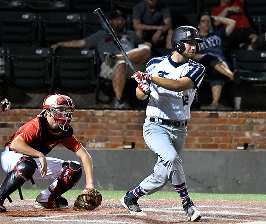 Enid Major's Matt Conerly advances the runner against the SW Shockers Black during elimination game in the Connie Mack state tournament Friday July 14, 2017 at David Allen Memorial Ballpark. (Billy Hefton / Enid News & Eagle)