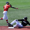 Woodward's Parker Ward throws over against OKC Sandlot's Alex Andrews attempting a doubleplay Friday July 20, 2018 during an elimination game in the Connie Mack South Plains Regional Tournament. (Billy Hefton / Enid News & Eagle)