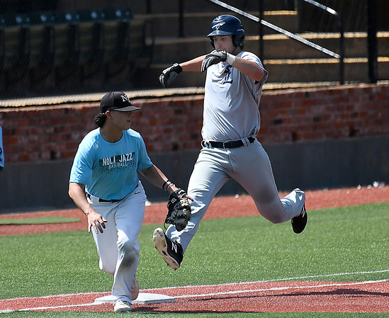 Enid Majors' Evan Kowalski beats out a ground ball for an infield hit against NOLA during the Connie Mack South Plains Regional Tournament Thursday July 19, 2018 at David Allen Memorial Ballpark. (Billy Hefton / Enid News & Eagle)