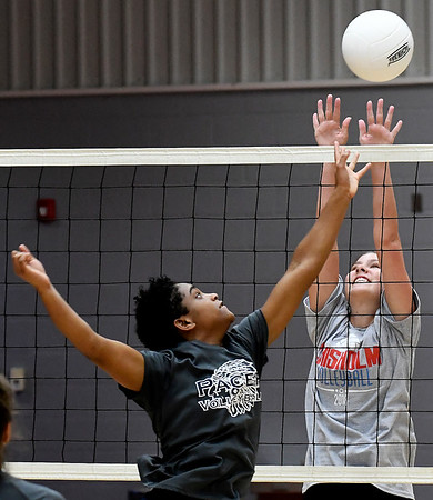 Enid D'Sani Levy tries to hit the ball pass Chisholm's Brooklyn Wilson during a scrimmage at Chisholm Middle School Tuesday July 31, 2018. (Billy Hefton / Enid News & Eagle)