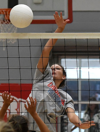 Chisholm's Courtney Petersen hits the ball during a scrimmage at Chisholm Middle School Tuesday July 31, 2018. (Billy Hefton / Enid News & Eagle)