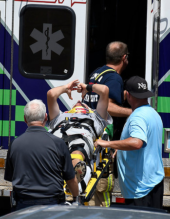Enid Majors' Ryan Stotts is loaded into an ambulance after running into the outfield wall during the Connie Mack South Plains Regional Tournament game against NOLA Thursday July 19, 2018 at David Allen Memorial Ballpark. (Billy Hefton / Enid News & Eagle)
