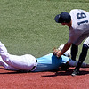Enid Majors' Bryce Osmond tags out NOLA's Nick Webre diving back into second base during the Connie Mack South Plains Regional Tournament Thursday July 19, 2018 at David Allen Memorial Ballpark. (Billy Hefton / Enid News & Eagle)