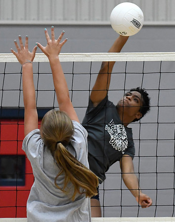 Enid's D'Sani Levy hits the ball during a scrimmage at Chisholm Middle School Tuesday July 31, 2018. (Billy Hefton / Enid News & Eagle)