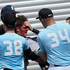 Enid Majors' Ryan Stotts is carried off the field after running into the outfield wall during the Connie Mack South Plains Regional Tournament game against NOLA Thursday July 19, 2018 at David Allen Memorial Ballpark. (Billy Hefton / Enid News & Eagle)
