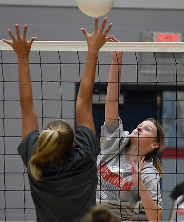 Chisholm's Gabby Bartley hits the ball during a scrimmage at Chisholm Middle School Tuesday July 31, 2018. (Billy Hefton / Enid News & Eagle)