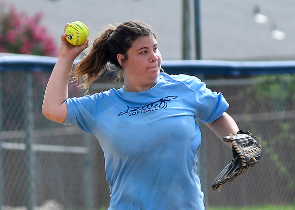 Enid's Haylee Schwandt makes a throw during the first day of practice July 16, 2018 at Pacer Field. (Billy Hefton / Enid News & Eagle)