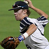 Enid Majors' Ambren Voitik makes a throw to first against Stix Davenport Wednesday July 18, 2018 at David Allen Memorial Ballpark during the Connie Mack South Plains Regional Tournament. (Billy Hefton / Enid News & Eagle)