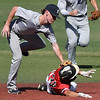Enid Majors' Ambren Voitek tags out DFW Twins' Brady Evans Friday, July 19, 2019 during the Connie Mack Regional Tournament at David Allen Memorial Ballpark. (Billy Hefton / Enid News & Eagle)