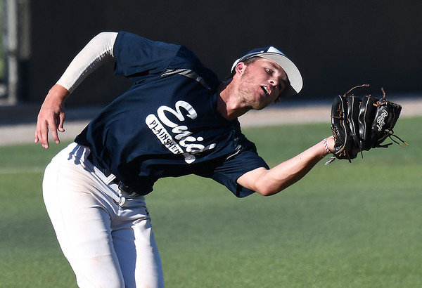Enid Plainsmen's Blake Priest catches a pop up against MVP Seng during the Connie Mack state Tournament Thursday, July 11, 2019 at David Allen Memorial Ballpark. (Billy Hefton / Enid News & Eagle)