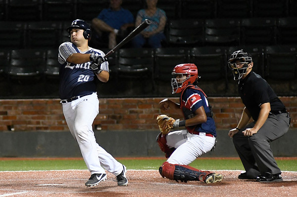 Enid Majors' Jordan Coffey bats against Woodward during the Connie Mack state tournament Friday, July 12, 2019 at David Allen Memorial Ballpark. (Billy Hefton / Enid News & Eagle)