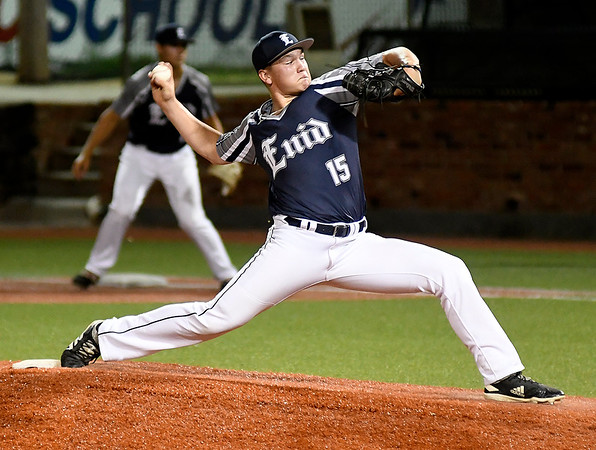 Enid Majors' Braden Pierce delivers a pitch against Woodward during the Connie Mack state tournament Friday, July 12, 2019 at David Allen Memorial Ballpark. (Billy Hefton / Enid News & Eagle)