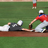 MVP's landry kyle attempts to tag 417 Mets' Cade Carlson during the Connie Mack South Plains Regional Friday, July 10, 2020 at David Allen Memorial Ballpark. (Billy Hefton / Enid News & Eagle)