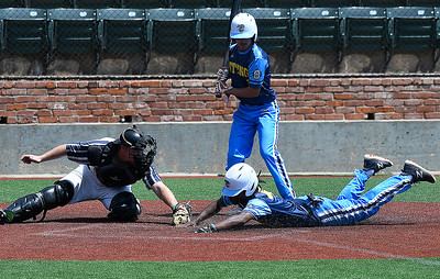 St. Louis Sting's Darryl Williams III's steals home ahead of the tag from Enid Major's Blake Scott during the Connie Mack South Plains Regional Tournament Thursday, July 9, 2020 at David Allen Memorial Ballpark. (Billy Hefton / Enid News & Eagle)