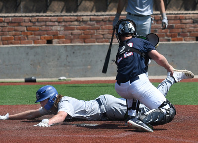 Enid Majors' Piersen McElyea dives pass Midwest Nationals' Noah Southern to score during the Connie Mack South Plains Regional Tournament Saturday, July 11, 2020 at David Allen Memorial Ballpark. (Billy Hefton / Enid News & Eagle)