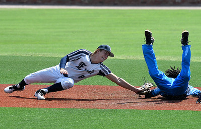 Enid Major's Connor Gore attempts to tag St. Louis Sting's Darryl Williams III during the Connie Mack South Plains Regional Tournament Thursday, July 9, 2020 at David Allen Memorial Ballpark. (Billy Hefton / Enid News & Eagle)