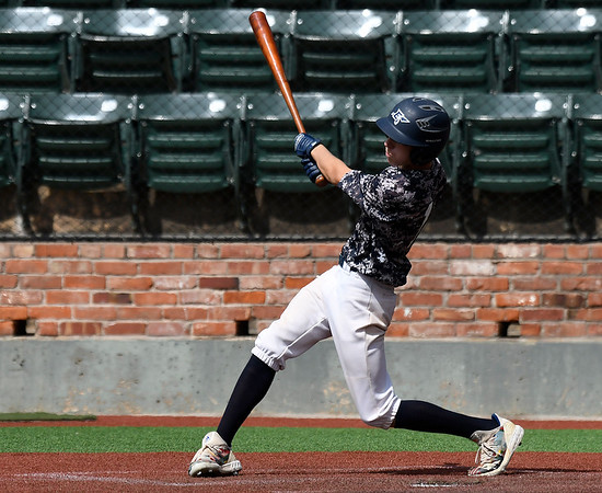 Enid Plainsmen's Kade Goeke connects on a single against Flat Bill 17U during the Connie Mack South Plains Regional Tournament Wednesday July 8, 2020 at david Allen Memorial Ballpark. (Billy Hefton / Enid News & Eagle)