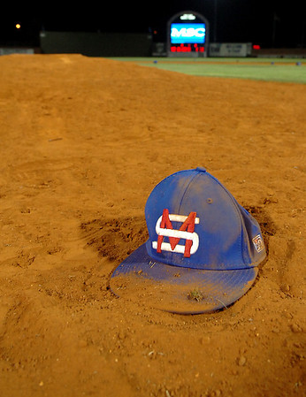 A Murray State ball cap rest on the dirt of the pitching mound after the Aggies defeated LSU-Eunice 4-3 to the win the NJCAA Div II World Series Saturday at David Allen Memorial Ballpark. (Staff Photo by BILLY HEFTON)