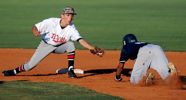 The Bartlesville shortstop has position for the tag on Enid Majors' Junior Obeso in the bottom of the second inning at David Allen Memorial Ballpark Friday, June 28, 2013. (Staff Photo by BONNIE VCULEK)