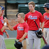 The Hutchinson Cardinals celebrate their 14-2 lead in the top of the 4th inning over the Majors at David Allen Memorial Ballpark Saturday, June 22, 2013. (Staff Photo by BONNIE VCULEK)