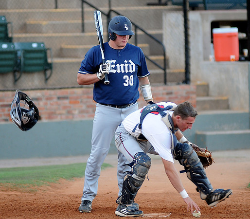 Enid Majors' designated hitter, Cody Daylor, watches as Bartlesville's catcher snags a low pitch at the plate in the bottom of the second inning at David Allen Memorial Ballpark Friday, June 28, 2013. (Staff Photo by BONNIE VCULEK)