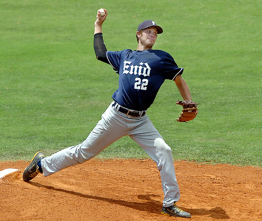 Enid's Nathan Melton delivers a pitch against Hutchinson Sunday at David Allen Ballpark. (Staff Photo by BILLY HEFTON)