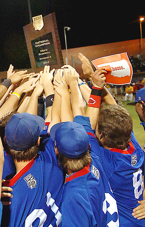 Murray State players reach for the championship trophy after defeating LSU-Eunice 4-3 to the win the NJCAA Div II World Series Saturday at David Allen Memorial Ballpark. (Staff Photo by BILLY HEFTON)