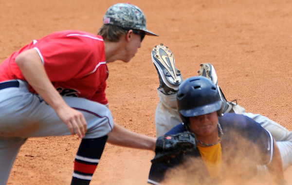 Bartlesville Indians' Tyler Yardley tags Enid Majors' Claytin Beaver out at first during the Indians' 10-4 win at David Allen Memorial Ballpark Sunday, June 30, 2013. (Staff Photo by BONNIE VCULEK)