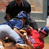 Enid Majors' Christian Voitik and Bartlesville Indians' Ryan Behar collide, popping the ball out of Voitik's glove as Behar scores during the Indians' 10-4 win over the Majors at David Allen Memorial Ballpark Sunday, June 30, 2013. (Staff Photo by BONNIE VCULEK)
