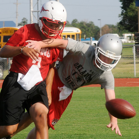 Chisholm's Taggart Brown (left) breaks up a pass intended for an Oklahoma Bible Academy receiver during the CHS 7-on-7 football camp Thursday, June 20, 2013, at Longhorn Field. (Staff Photo by BONNIE VCULEK)
