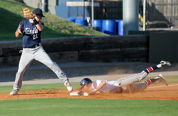 Bartlesville's Josh Moore slides into third as Enid Majors' Brady Kokojan makes the catch in the top of the first inning at David Allen Memorial Ballpark. After two, the Majors and the Indians were tied 1-1. (Staff Photo by BONNIE VCULEK)