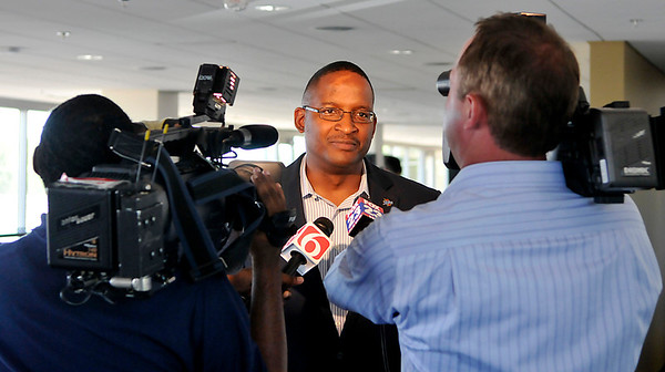 Dr. Derrick Gragg, new athletic director at the University of Tulsa, does an interview inside the H.A. Chapman Stadium press box Tuesday during a meet and greet with member of the media. (Staff Photo by BILLY HEFTON)