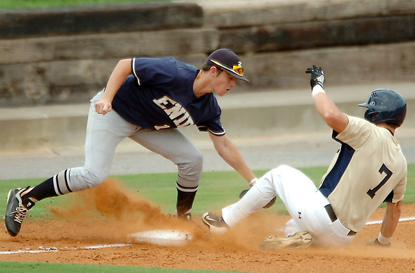 Enid's Braden Rogers tags out Cameron Knight of the OKC Sandlot at third base Tuesday at David Allen Ballpark. (Staff Photo by BILLY HEFTON)