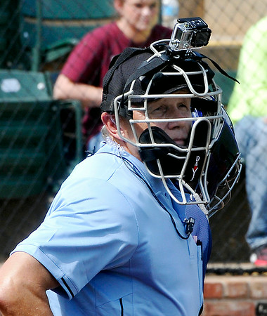 A home plate umpire wears a camera during the Connie Mack Regional Qualifing torunament Thursday at David Allen memorial Ballpark. (Staff Photo by BILLY HEFTON)
