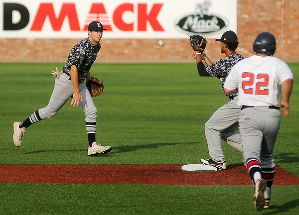Enid Majors' shortstop, Brady Kokojan (left), flips the ball to Xaiver Sundman for the force out at second during a game against Bartlesville at David Allen Memorial Ballpark Saturday, June 28, 2014. (Staff Photo by BONNIE VCULEK)
