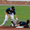 Enid's Brady Kokojan applies the tag on Bartlesville's Ryan Behar attempting to steal second Friday at David Allen Memorial Ballpark. Behar over slid the base and was out on the play. (Staff Photo by BILLY HEFTON)