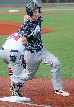 Enid Majors' Bradley Kinsey beats the throw to first during Saturday's game against Bartlesville at David Allen Memorial Ballpark. (Staff Photo by BONNIE VCULEK)