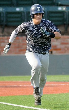 Enid Majors' Kros Bay sprints to first base during a game against Bartlesville Saturday, June 28, 2014. (Staff Photo by BONNIE VCULEK)
