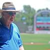 Shannon Enfield, the Connie Mack national vice president for South Plains Region, roams David Allen Memorial Ballpark during the baseball qualifier tournament Saturday, June 21, 2014. (Staff Photo by BONNIE VCULEK)