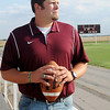Gus Overstreet, Pioneer High School's new head football coach, glances around the Mustangs' football field Thursday, June 5, 2014. Overstreet, who helped Pioneer finish as the 2005 OSSAA Class B Football State Runner-up, coached at Covington-Douglas the past two years, but returns to his alma matter to restore the Mustang's winning tradition. (Staff Photo by BONNIE VCULEK)