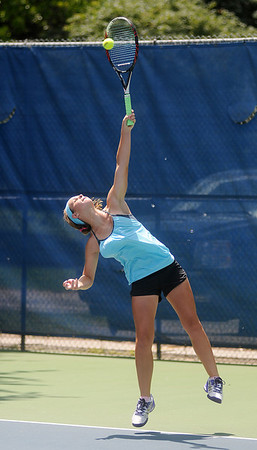 Grace Dillingham serves to Sarah Reilly at Oakwood Country Club Saturday, June 21, 2014. Reilly won the match 6-4, 6-2. (Staff Photo by BONNIE VCULEK)