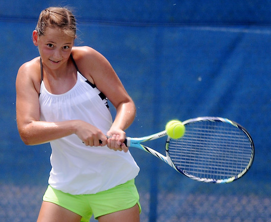 Sarah Reilly hits a return to Grace Dillingham at Oakwood Country Club Saturday, June 21, 2014. Reilly won the match in straight sets 6-4 and 6-2 in the 14-under age group. (Staff Photo by BONNIE VCULEK)